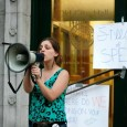 Skye Schmelzer of Students for Democratic Society speaks in front of City Hall.