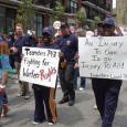 Teamsters Local 743 signs in immigrants rights march