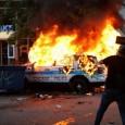 Anger at police crimes boils, Chicago police car burns.