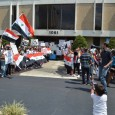 "Protest at Congressman Crenshaw's office to demand ""Hands off Syria""."
