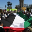 Palestine solidarity activists wield  huge flag