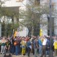 Large group of people protesting FBI raids in Minneapolis