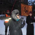 Anh Pham speaking at January 25 protest in Minneapolis