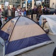 Protesters in tents block intersection in front of U.S. Bank