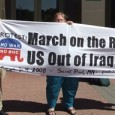 "Press conference organizers carry banner, ""March on the RNC! US Out of Iraq!"""
