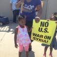 Children join protest against war on Syria.