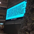 Huge electronic billboard threatens protesters with arrest at Mall of America.