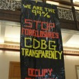 Occupy protesters drop banner in City Hall