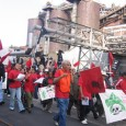 Tobacco workers and supports marching in street.