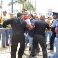 A photo of police arresting protesters of the SEIU raid