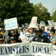 Teamsters Local 743 banner at the head of the contingent.