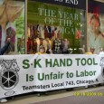 "Workers holding a sign that says ""SK Hand Tool is Unfair to Labor"""