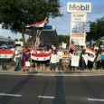 Syrian Americans waving signs and flags.