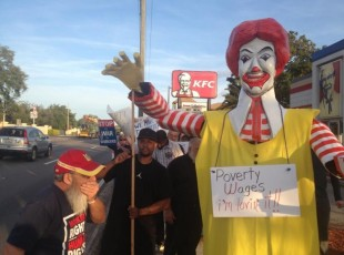 Striking workers marching on fast food chains, demanding better wages and union