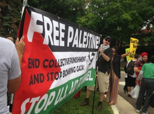 Anti War Committee banner at Gaza solidarity protest.