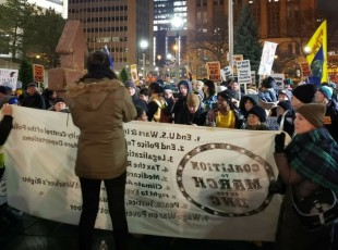 Milwaukee protest confronts Trump visit.