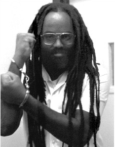 biography off mumia abu jamal as a political prisoner on the death row in pennsylvania since 1981 On may 13, 1985, after complaints from neighbors, as well as indictments of numerous move members for crimes including parole violation, contempt of court, i a pennsylvania state police helicopter then dropped two one-pound bombs made of fbi-supplied water gel explosive, a dynamite substitute,.