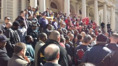 Rally at NY city hall for fired UPS drivers.