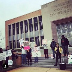 Protesters gather outside the Waller County Courthouse in Hempstead, Texas.