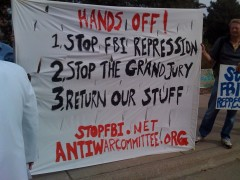 Banner at 10/23 action calling on Obama to stop FBI repression