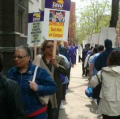 picket sign reads: John Loya: Bad Man on Campus