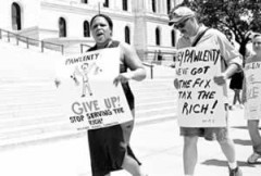 """Protest sign: """"Pawlenty, Give up!"""""""