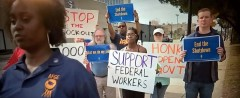 Federal workers and other trade unionists rally against the shutdown in Jacksonv