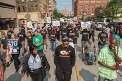 Striking Milwaukee bus drivers march