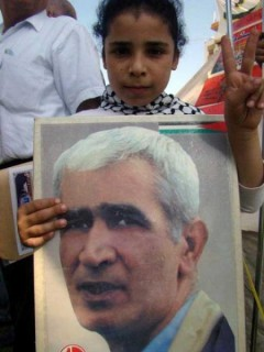 Palestinian child holding poster of Ahmad Sa'adat.