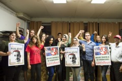 NYC activists raise their fist in solidarity with Bilal Kayed