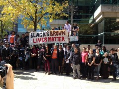 Participants in Milwaukee Black and Brown solidarity rally against deportations