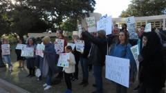 Dallas protest slams Texas Governor Greg Abbott's anti-refugee statements.