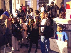 Tefa Galvis speaks to the press on the steps of the courthouse demanding justice