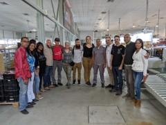 FRSO labor delegation at laptop factory.