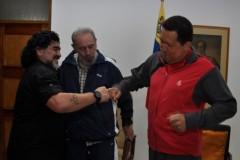 Maradona with Hugo Chavez and Fidel Castro.