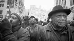 Frank Chapman marching in Chicago Black Friday protest demanding justice.