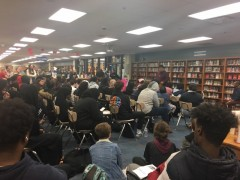 Frank Chapman speaking in the South High library, at Black History Month event.