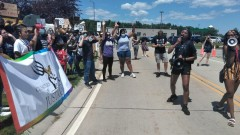 Coalition to March on the DNC protests Trump visit in Green Bay, WI.