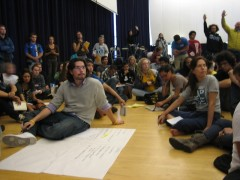 Dozens of students discussing, raising hands to vote on protest for UCLA Regents
