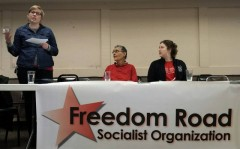 Stephanie Taylor (standing) of Freedom Road Socialist Organization speaking at T