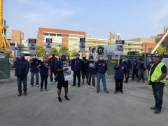 Union construction workers refuse to cross picket line at UIC.