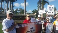 Anti-war protesters oppose war on Korea  at Trump resort in Miami.