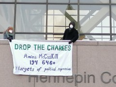 Protest demands drop the charges against Amina McCaskill.