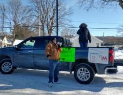 Locked out Marathon worker speaks at rally before start of  car caravan.