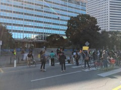 Protesters rally in front of City Hall