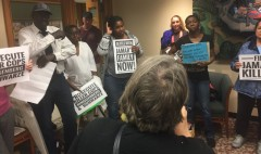 Protest for justice for Jamar Clark at Minneapolis mayor's office.