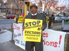 Man holding a Stop Foreclosures sign in Minneapolis