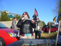 Jess Sundin, of Anti War Committee, speaking at protest in front of Senator Klob