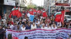 Palestinians protest Zionist annexation plans.