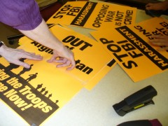 Preparing signs for anti war march
